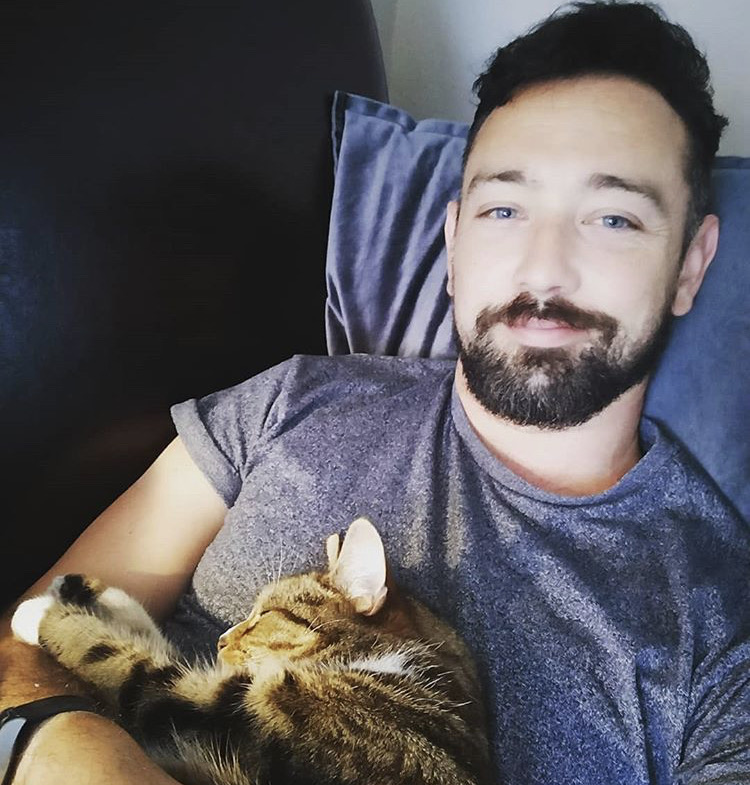 Photo of Jordan with his beloved cat Tabby